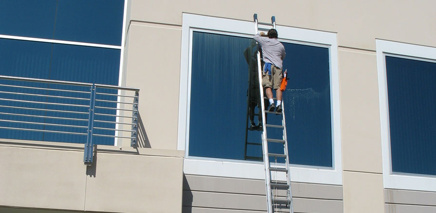 Paul Black cleaning a 2nd story window of a commercial building in Rocklin, CA.