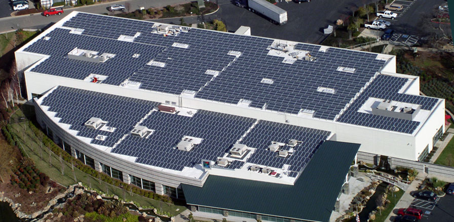 Commercial building. The roof is covered with hundreds of solar panels which are cleaned by Paul Blacks.